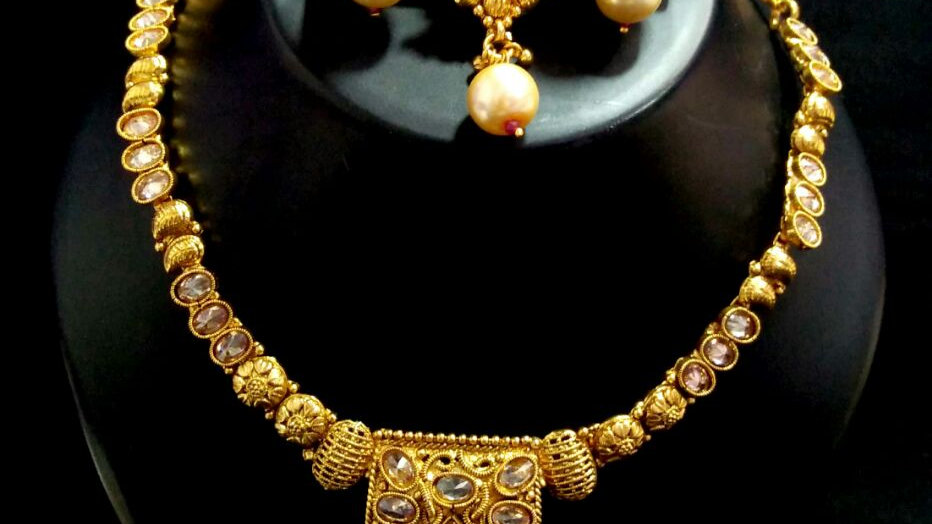 Gold plated necklace studded with kundan stones