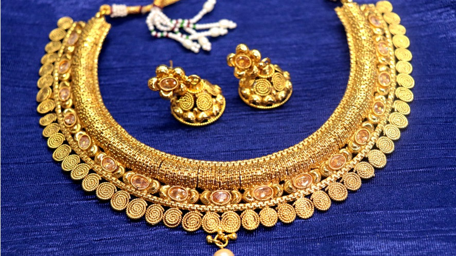Gold plated necklace studded with semi precious stones