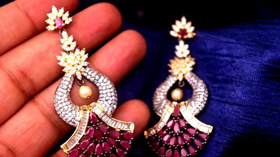 Red coloured ,Awesome American Diamond Danglers with warranty