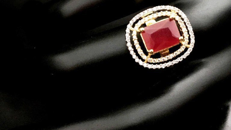 Red coloured Beautiful and elegantly designed American diamond finger ring