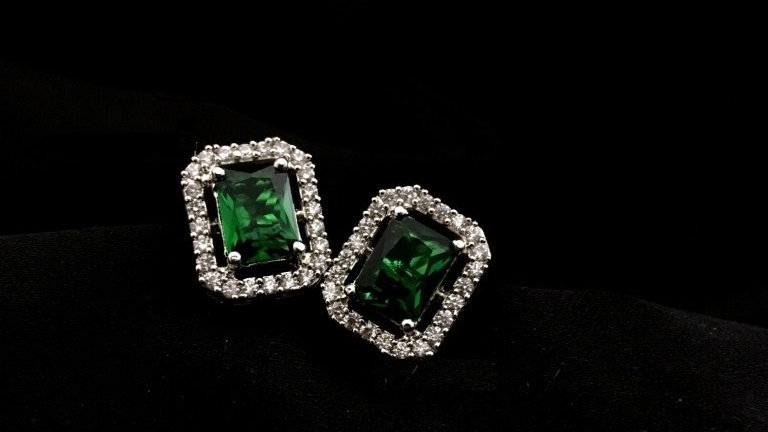Green coloured,small and elegant american diamond stud