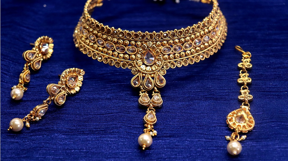 Buy this precious Gold Plated Necklace Set with an year warranty