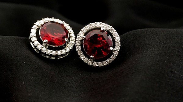 Red coloured American Diamond Studs with warranty