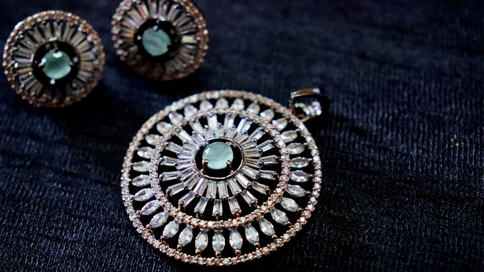 Blue coloured American diamond Pendant set with warranty
