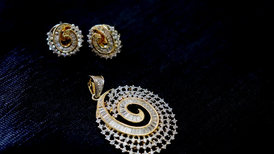 Oval Shaped High quality American Diamond Pendant set,along with beautiful studs