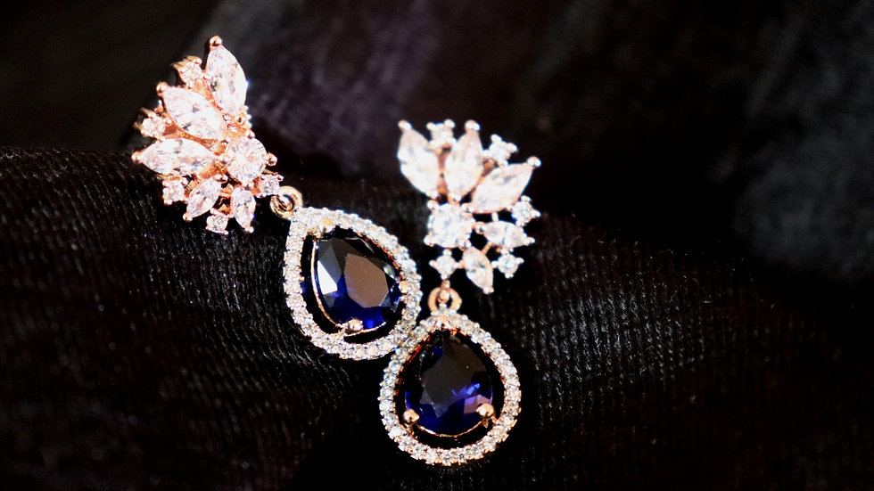 Navy blue coloured American diamond earring with warranty