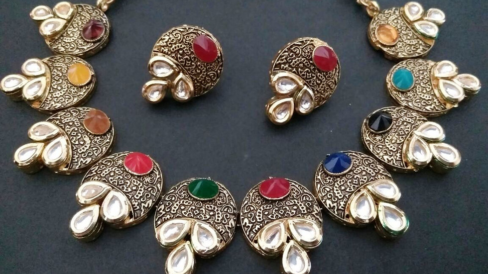 Gold plated necklace studded with American Diamond stones