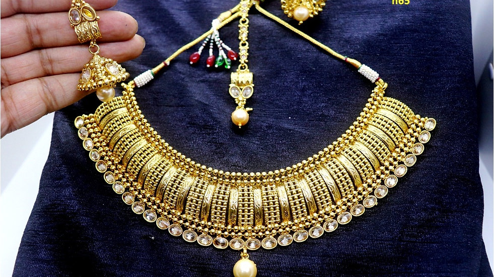 Gold Plated Necklace set with beautiful pair of gold plated Jhumki and Mangtika
