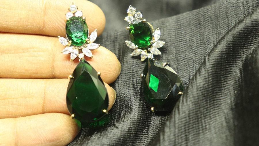 Green coloured American diamond earrings with warranty