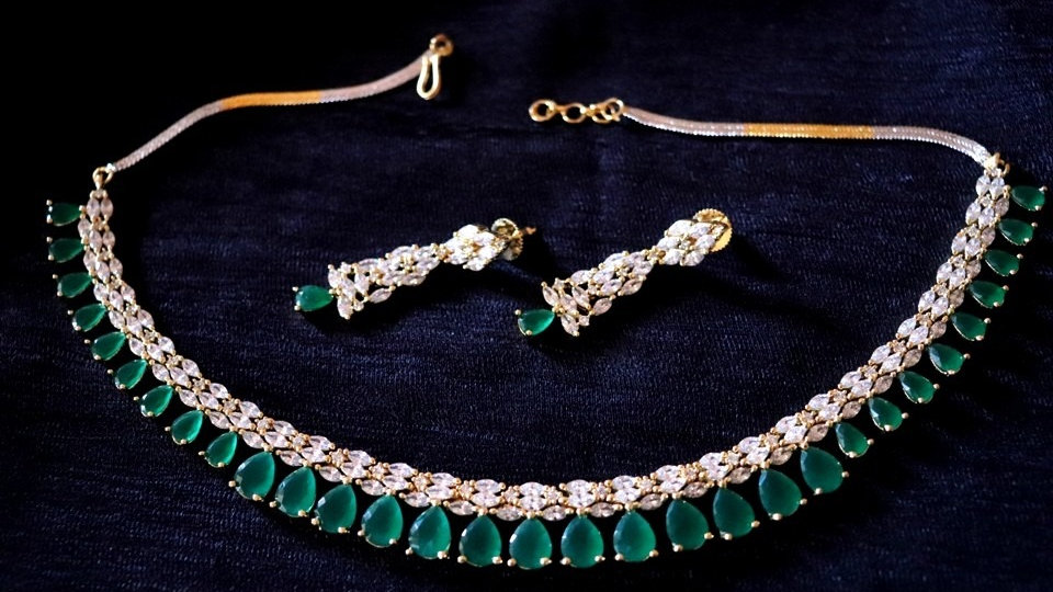 Stylish and Elegant Green Coloured American Diamond Necklace Set with Warranty