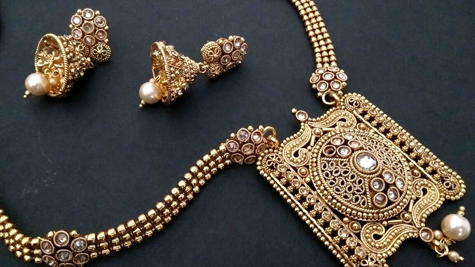Buy this precious Gold Plated Necklace Set with a year warranty