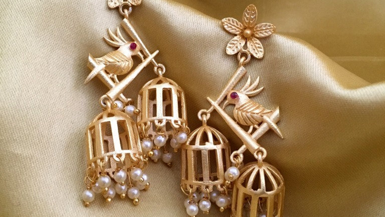 Gold plated earrings with warranty