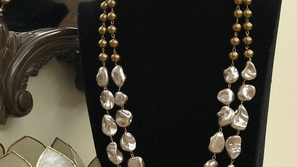 This Gorgeous Mala has baroque pearls and semi precious onyx stones