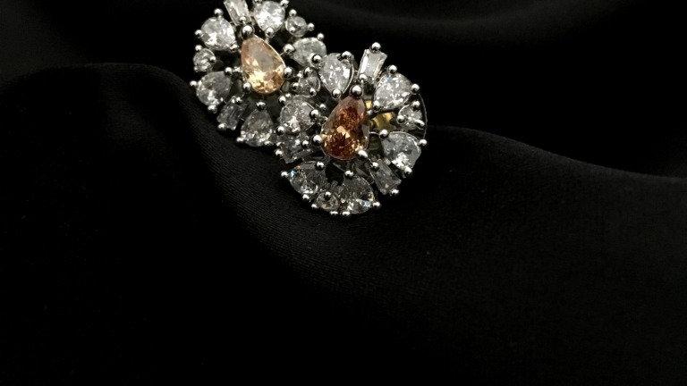 Beautiful pair of american diamond studs with warranty