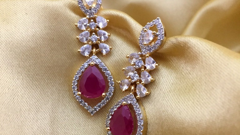 Red coloured American Diamond Earrings with an year warranty