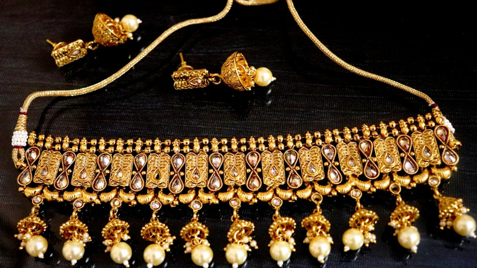 Gold plated necklace set studded with Kundan Stones and American Diamond Stones