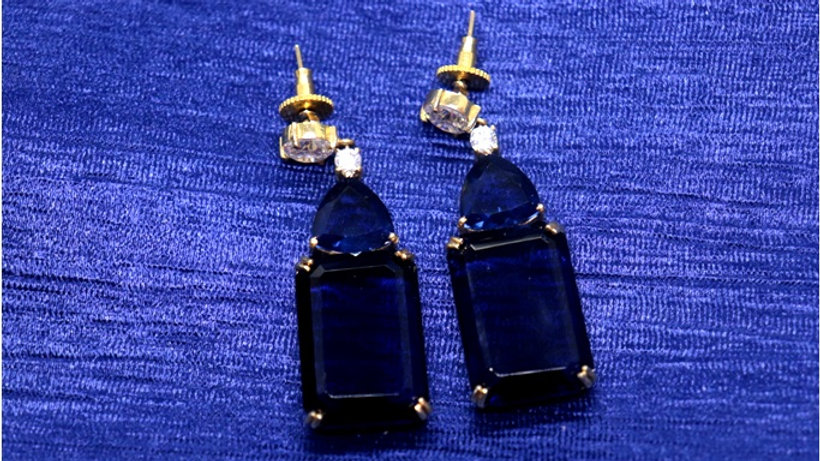 Navy blue coloured American Diamond earrings with an year warranty