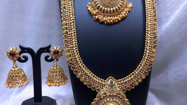 1 gram gold plated necklace set,studded with small american diamond stones