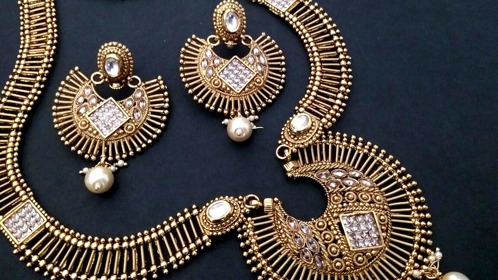 Buy this precious Gold Plated Necklace Set with a year warranty.
