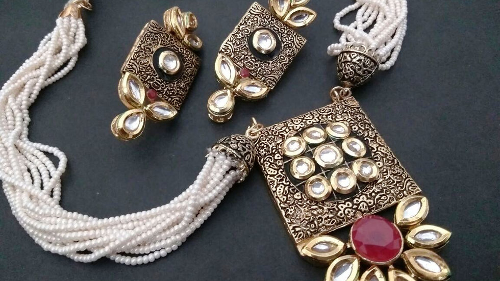 Gold plated necklace studded with Kundan and American Diamond stones