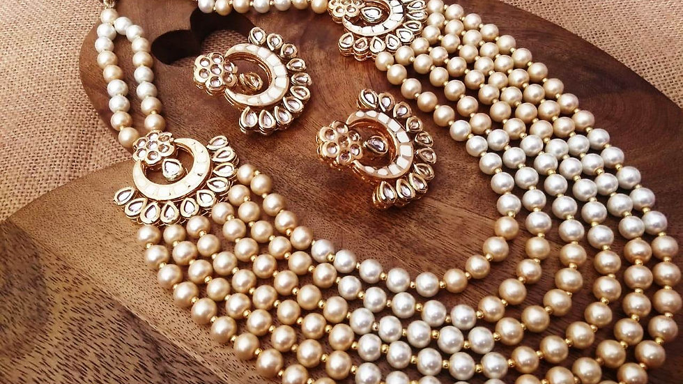 Buy this awesome Pearl Necklace set coupled with beautiful pearl jhumki