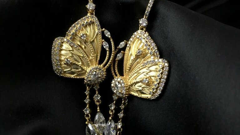 Beautiful Butterfly shaped gold plated+American Diamond Dangler /Jhumki with an