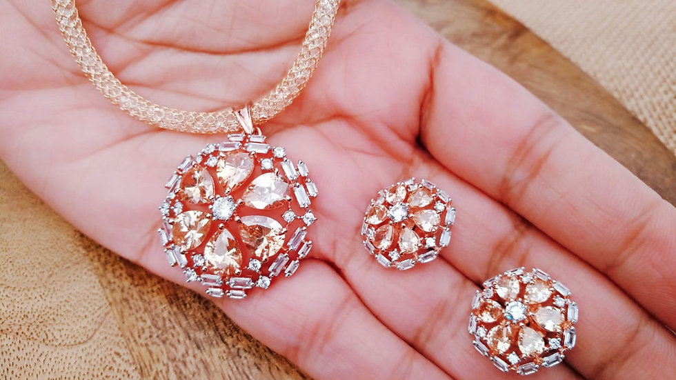 Champagne American Diamond Studded Pendant set along with beautiful pair of ea