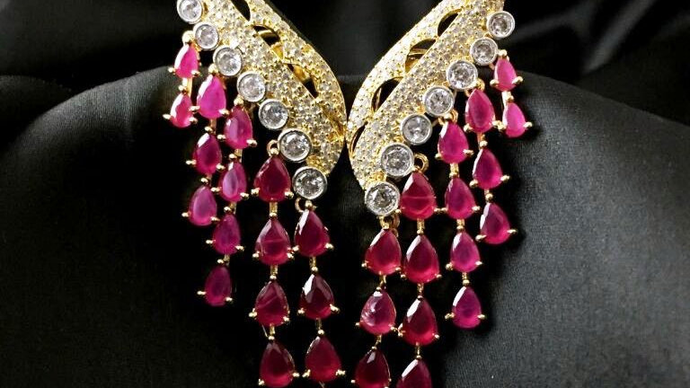 Red coloured american diamond ,multilayered earrings with warranty