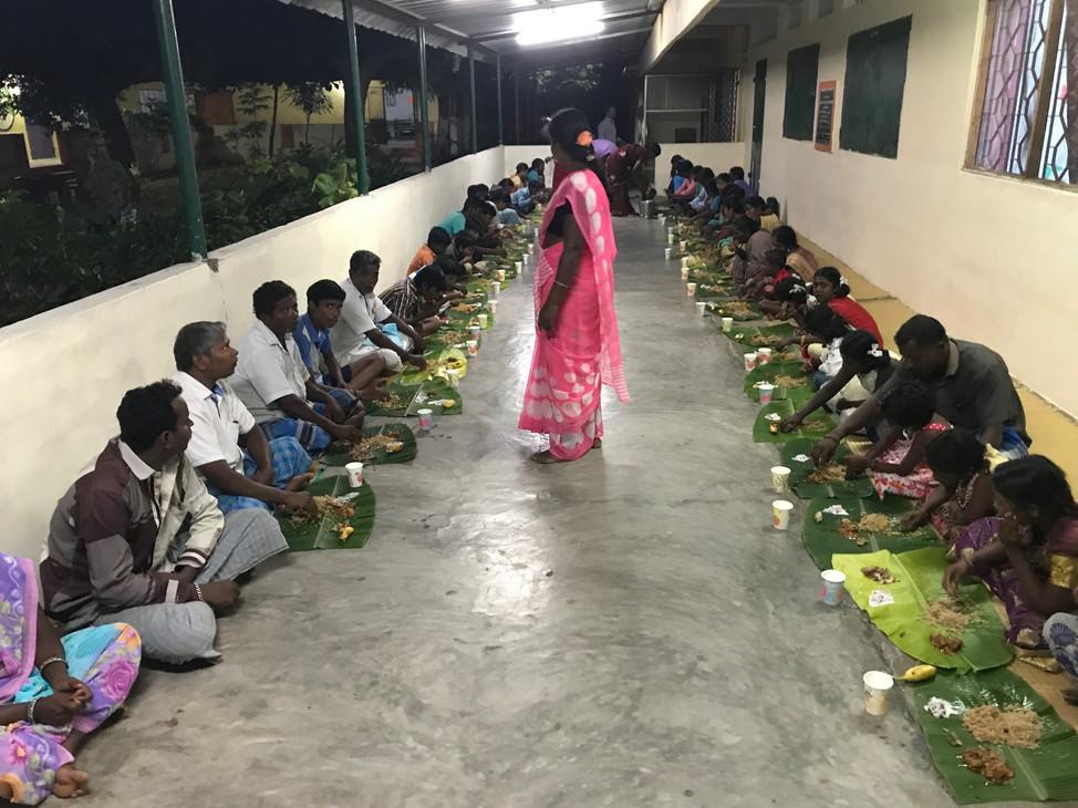 Villagers enjoying a meal 2019