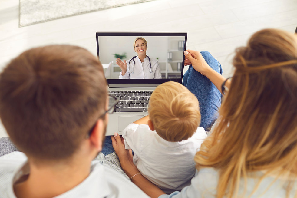 Family doctor online. Young family with a son makes a video call via laptop to a pediatric