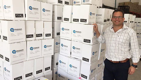 """Above: Mr. Dave Boulle, Managing Director of Mason Complete Office Solutions (Pty) Ltd with a batch of stationery to be delivered to subscribers of the """"Mason Back to School"""" programme."""