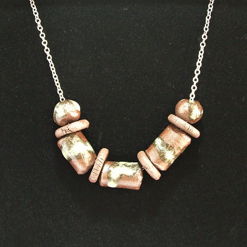 Ceramic and silver 'Float and Bouy' pendant by Tina Hill Art
