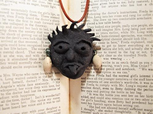 Black clay ladies head pendant by Tina Hill Art