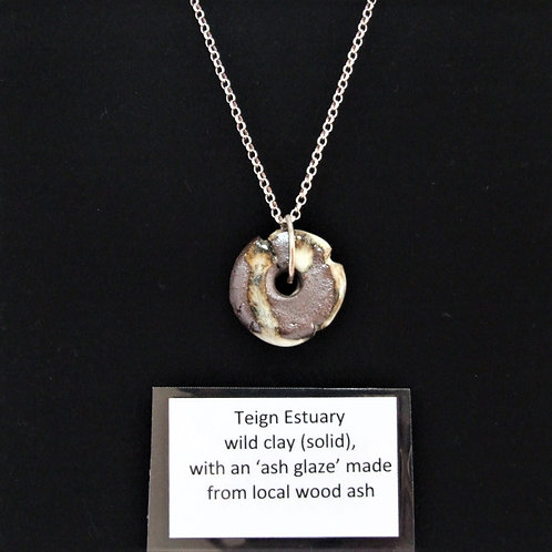 Ceramic and silver pendant by Tina Hill Art