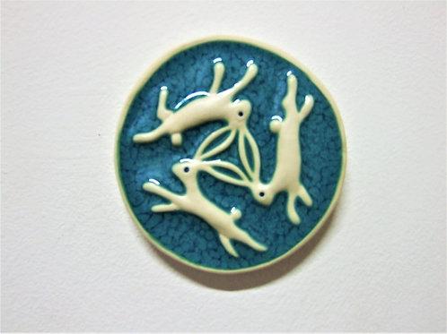 Round 'Three Hares' Ceramic Tile By Ann Mari Hopkin