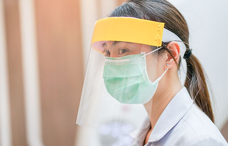 Medical staff wearing face shield and me