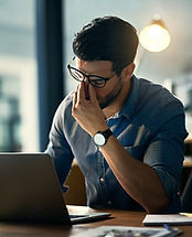 a man suffering from fatigue while working at his desk