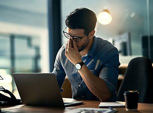 a man with adrenal fatigue at work