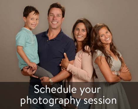 "Picture of family with the caption, "" Schedule your photography session"""