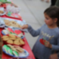 A cute girl enjoing home baked cookies at the Community Tree Lighting