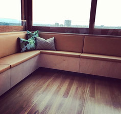 Lelievre Vinyl seating with Christopher Farr cushions