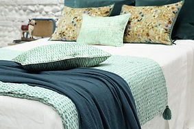 Elitis quilts and cushions for the bedroom