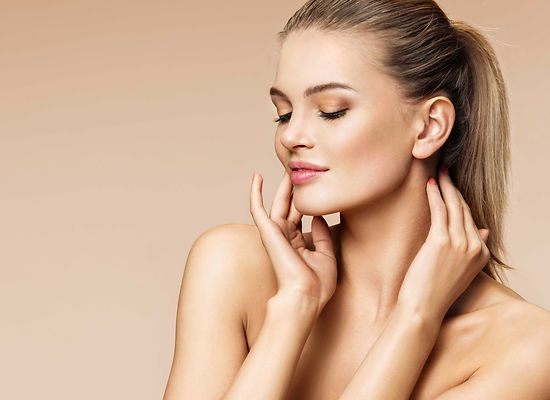 Blonde women touching lips   Enhanced Beauty Aesthetics