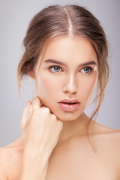 Women resting face on hand   Enhanced Beauty Aesthetics