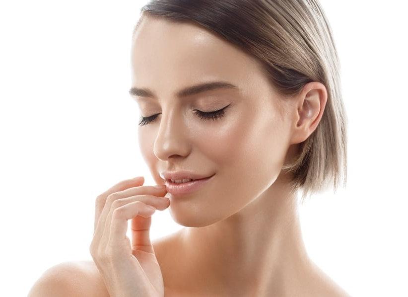Women touching lip   Enhanced Beauty Aesthetics