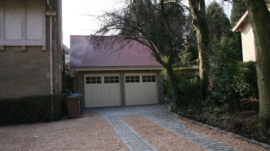 Garage to listed building