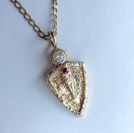 Sandcast pendant with diamond and ruby
