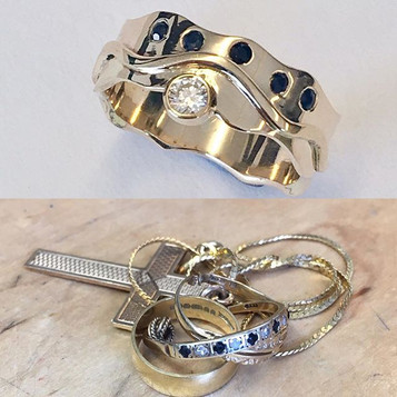 9ct gold diamond & sapphire ring, wave design with wave edges.