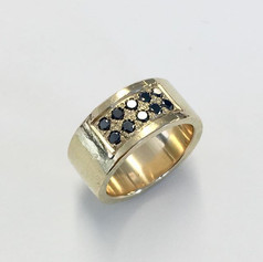 18ct gold mens ring pave set with black diamonds.