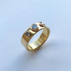 18ct gold band set with diamonds, bezel set.